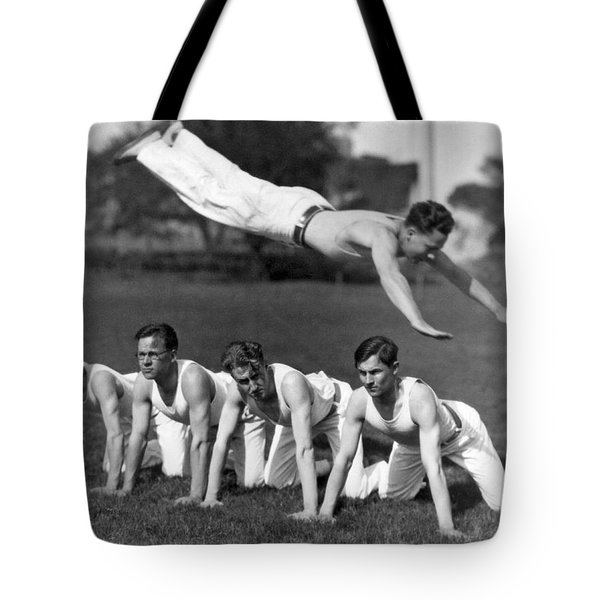 Acrobatic Swandive Tote Bag by Underwood Archives