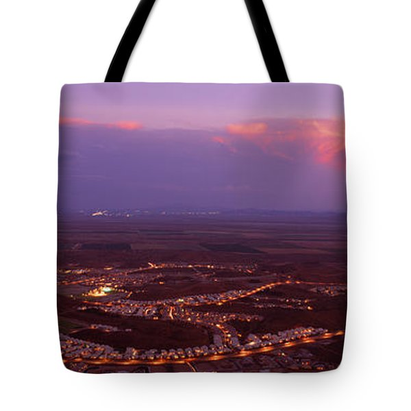 Aerial View Of A City Lit Up At Sunset Tote Bag