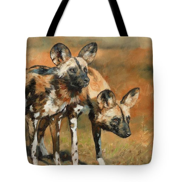 Tote Bag featuring the painting African Wild Dogs by David Stribbling