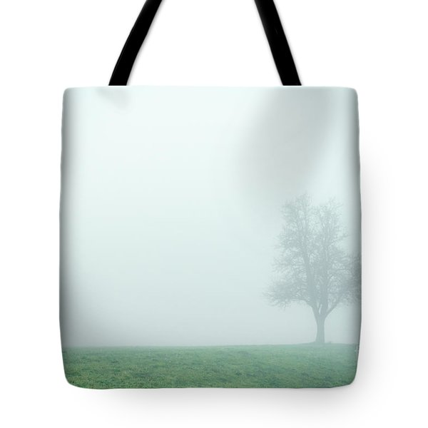 Alone In The Fog - Green Tote Bag by Hannes Cmarits