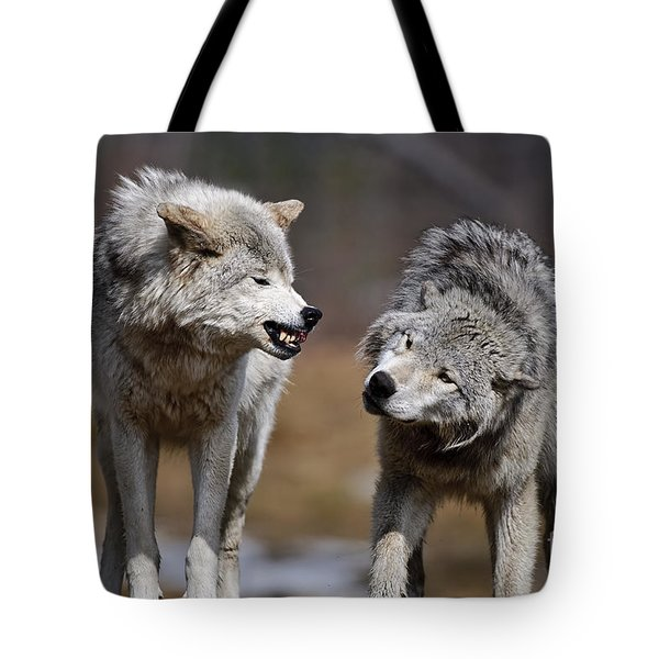 Tote Bag featuring the photograph Alpha Displeasure by Wolves Only