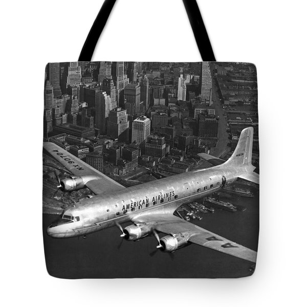 American Dc-6 Flying Over Nyc Tote Bag
