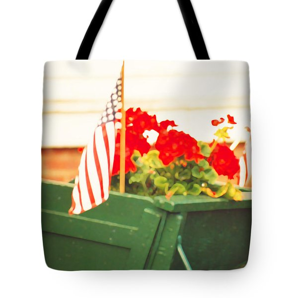 American Flags And Geraniums In A Wheelbarrow Two Tote Bag by Marian Cates