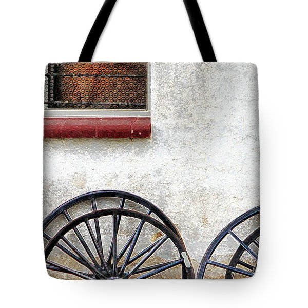 Tote Bag featuring the photograph Amish Buggy Wheels by Polly Peacock