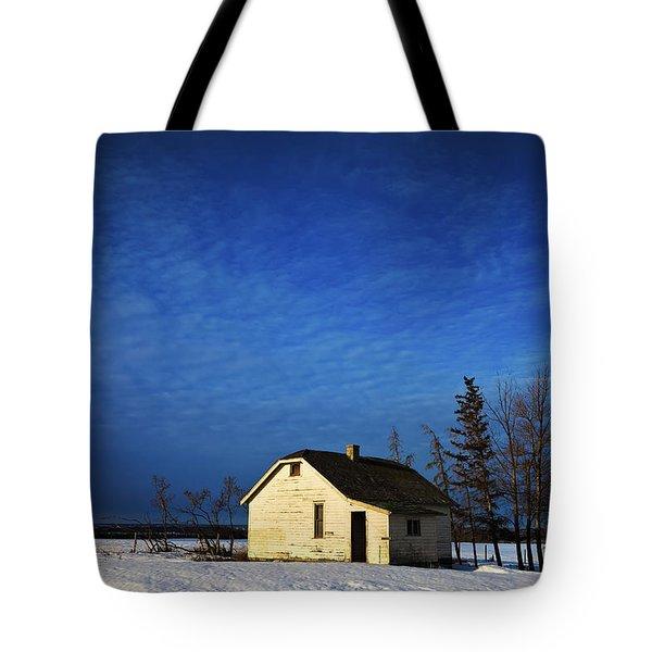 An Abandoned Homestead On A Snow Tote Bag by Steve Nagy
