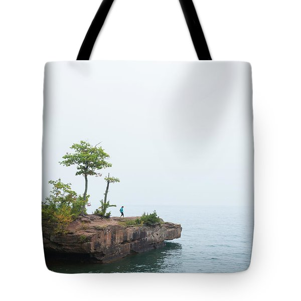 An Adult Woman Hiker Explores A Small Tote Bag