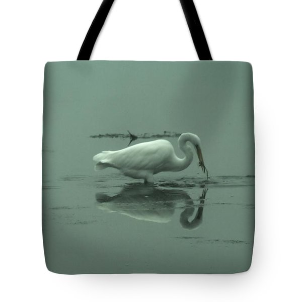 An Egret Feeding Tote Bag by Jeff Swan