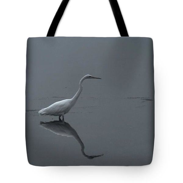 An Egret Standing In Its Reflection Tote Bag by Jeff Swan