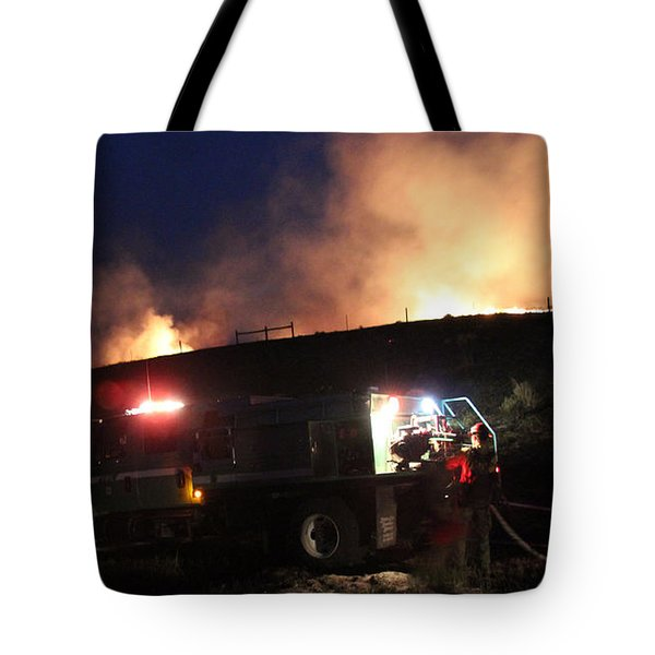 An Engine Crew Works At Night On White Draw Fire Tote Bag