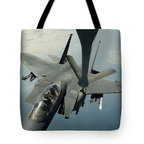 An F-15e Strike Eagle Receives Fuel Tote Bag by Stocktrek Images