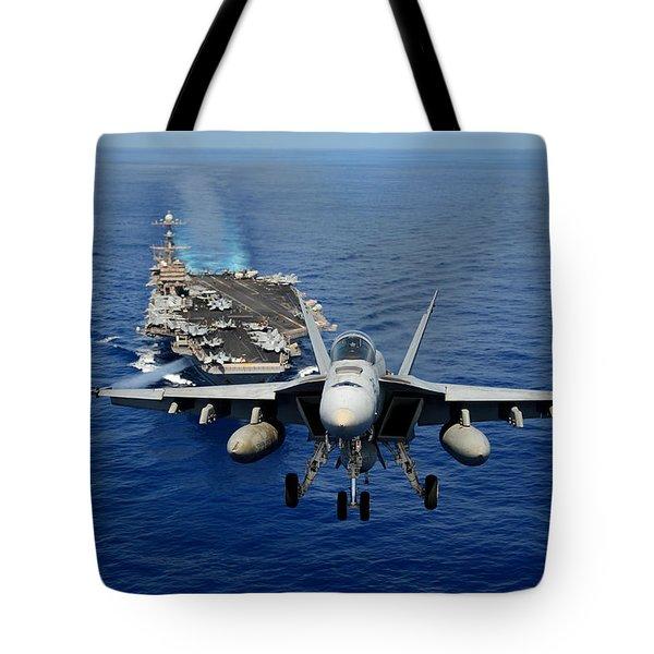 An F/a-18 Hornet Demonstrates Air Power. Tote Bag