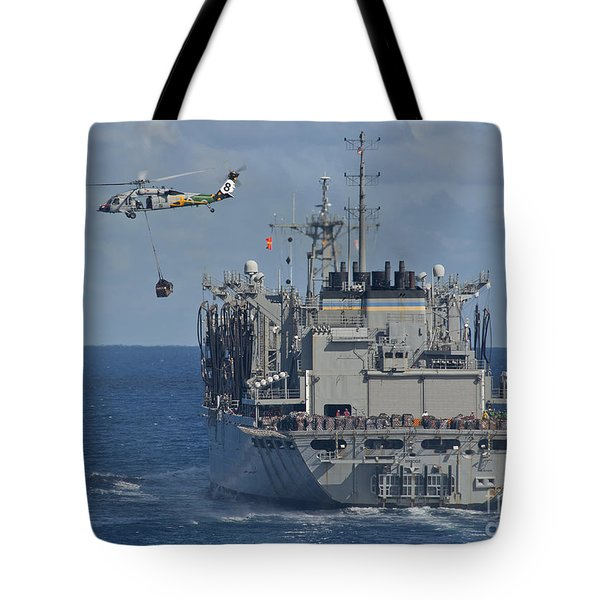 An Mh-60s Sea Hawk Conducts A Vertical Tote Bag by Stocktrek Images