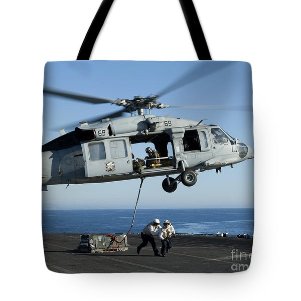 An Mh-60s Sea Hawk Helicopter Prepares Tote Bag by Stocktrek Images