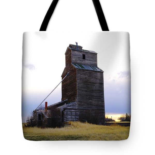 An Old Grain Elevator Off Highway Two In Montana Tote Bag by Jeff Swan