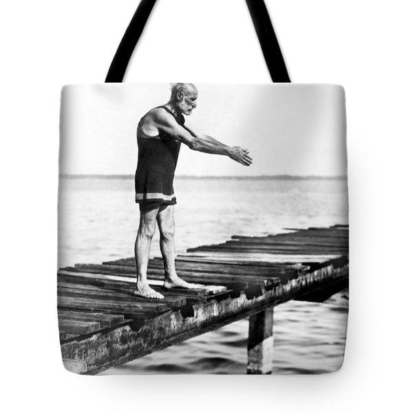 An Old Man Prepares To Dive Tote Bag