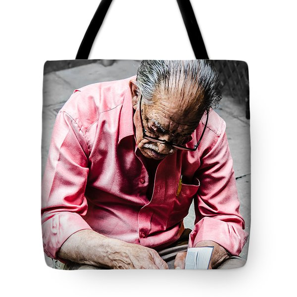 An Old Man Reading His Book Tote Bag by Sotiris Filippou