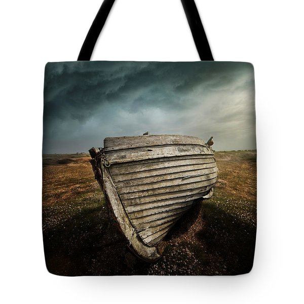 An Old Wreck On The Field. Dramatic Sky In The Background Tote Bag