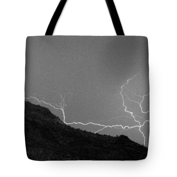 Tote Bag featuring the photograph An Uphill Run by J L Woody Wooden