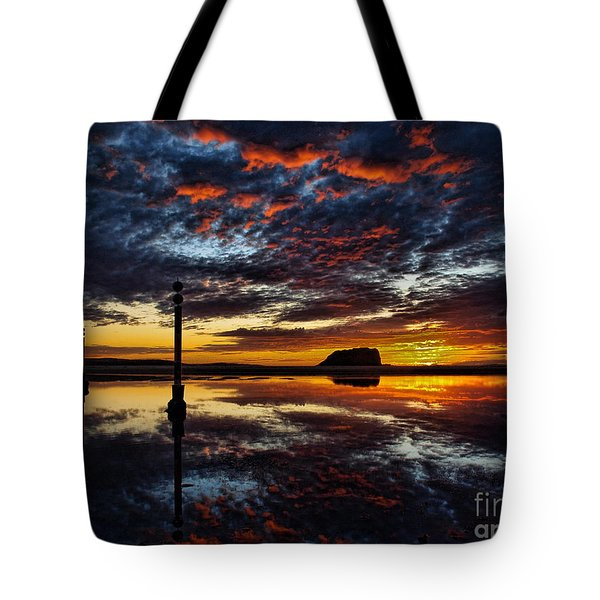 Tote Bag featuring the photograph Angry Sky by Trena Mara