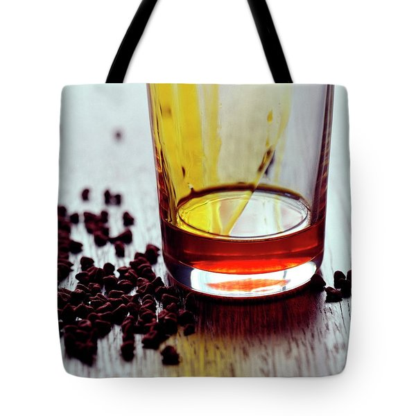 Annatto Seeds With A Glass Tote Bag