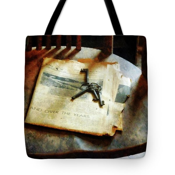 Tote Bag featuring the photograph Antique Keys On Newspaper by Susan Savad