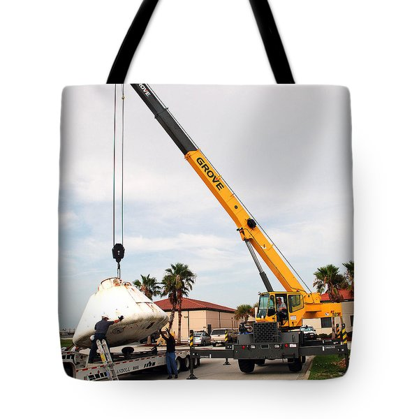 Tote Bag featuring the photograph Apollo Capsule Going In For Repairs by Science Source