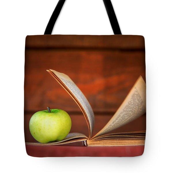 Apple And Book Tote Bag by Michal Bednarek