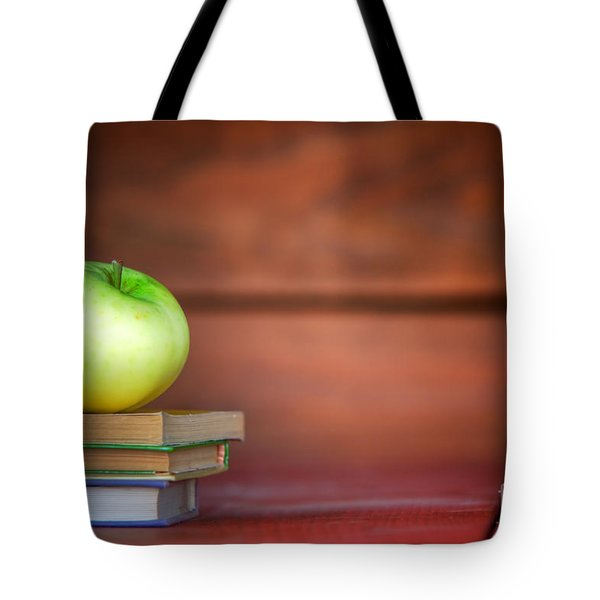 Apple On Pile Of Books Tote Bag by Michal Bednarek