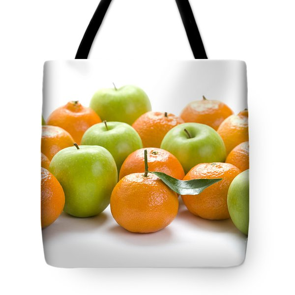 Tote Bag featuring the photograph Apples And Oranges by Lee Avison