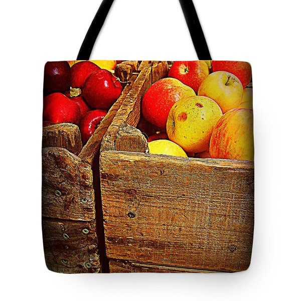 Tote Bag featuring the photograph Apples In Old Bin by Miriam Danar
