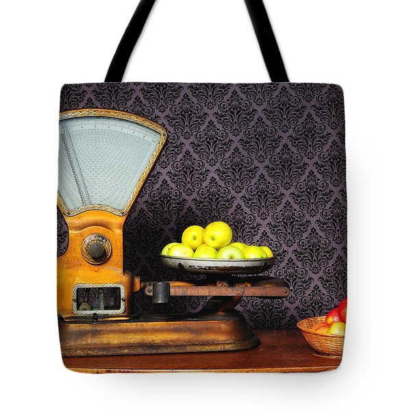 Apples On The Scale Tote Bag