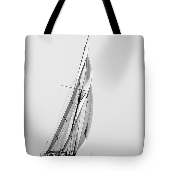 A Tall Ship In Mediterranean Water Approaching To Lighthouse Of Isla Del Aire - Menorca Tote Bag