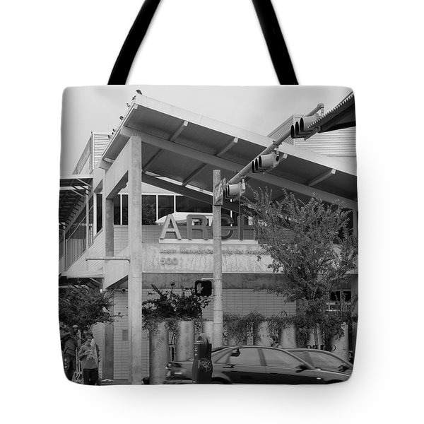 Tote Bag featuring the photograph A.r.c.h. Austin Resource Center For The Homeless Bw by Elizabeth Sullivan