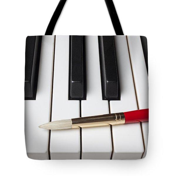 Artist Brush On Piano Keys Tote Bag by Garry Gay