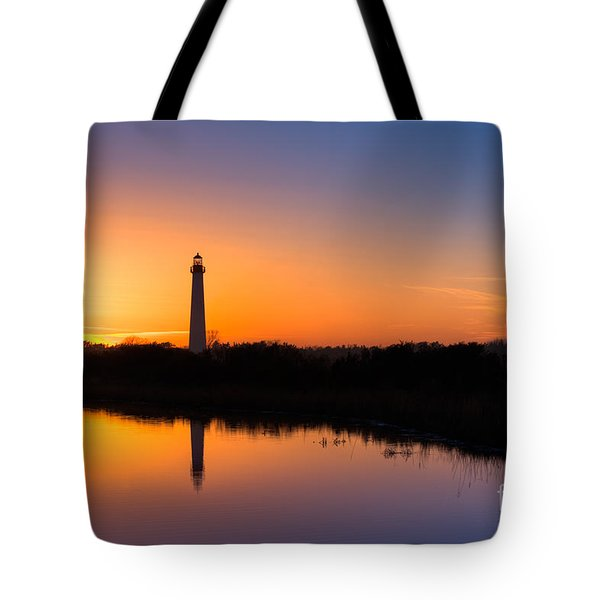 As The Sun Sets And The Water Reflects Tote Bag