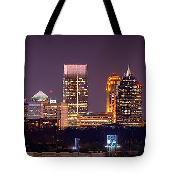 Atlanta Skyline At Night Downtown Midtown Color Panorama Tote Bag by Jon Holiday