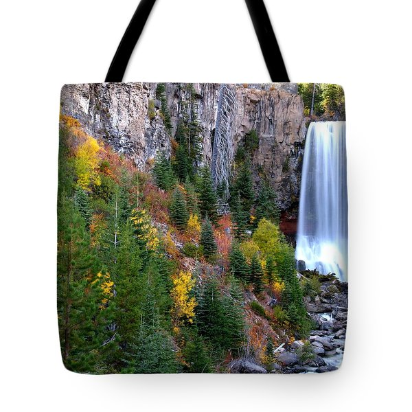 Tote Bag featuring the photograph Autumn Colors Surround Tumalo Falls by Kevin Desrosiers