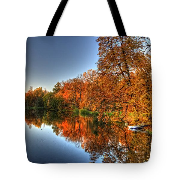 Tote Bag featuring the photograph Autumn Trees Over A Pond In Arkadia Park In Poland by Julis Simo