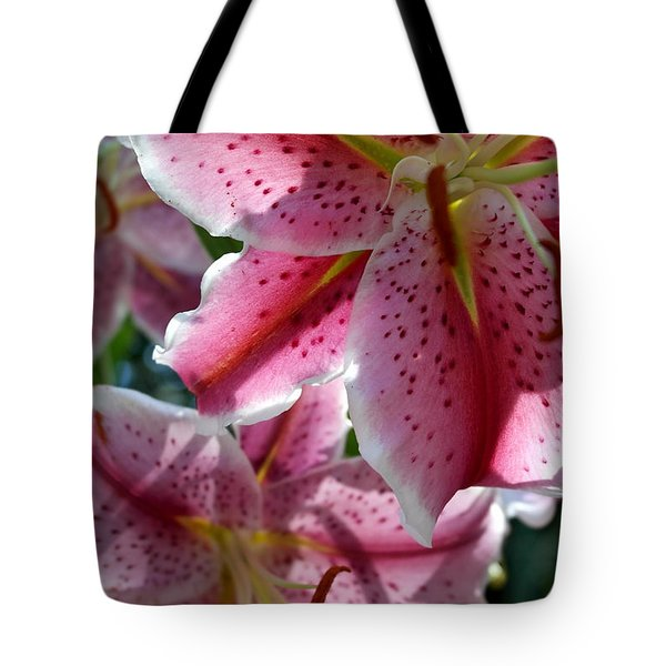 Tote Bag featuring the photograph Backlit Spotted Daylilies by Michele Myers