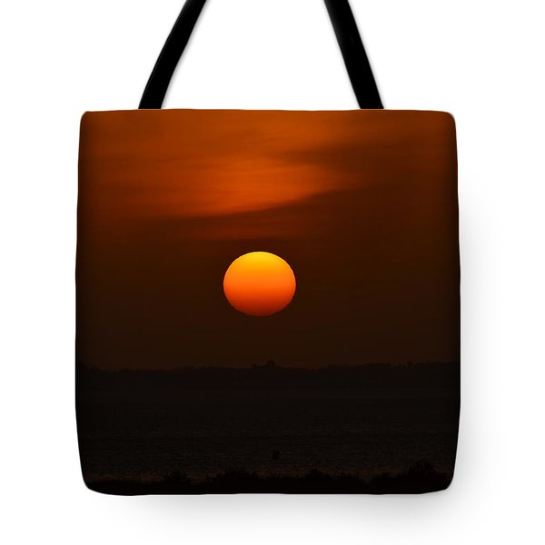 Tote Bag featuring the photograph Ball Of Fire by Debra Martz