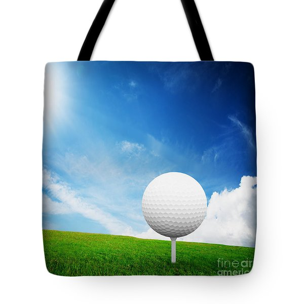 Ball On Tee On Green Golf Field Tote Bag by Michal Bednarek