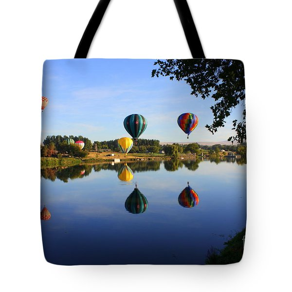 Balloons Heading East Tote Bag by Carol Groenen