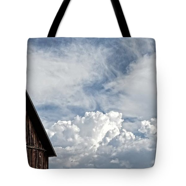 Tote Bag featuring the photograph Barn And Clouds by Joseph J Stevens