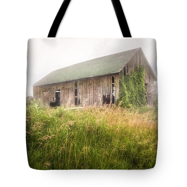 Tote Bag featuring the photograph Barn In A Misty Field by Gary Heller