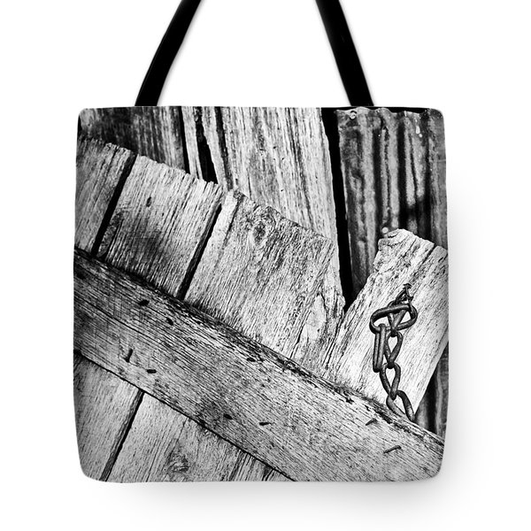 Tote Bag featuring the photograph Barn Wood Chain And Tin In Bw by Greg Jackson