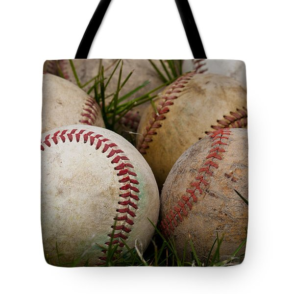 Baseballs On The Grass Tote Bag by David Patterson