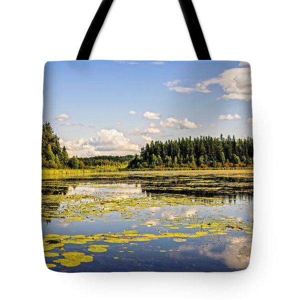 Bay At The Waskesiu Lake With Lily Tote Bag