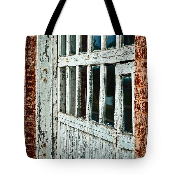 Tote Bag featuring the photograph Bay Door by Greg Jackson
