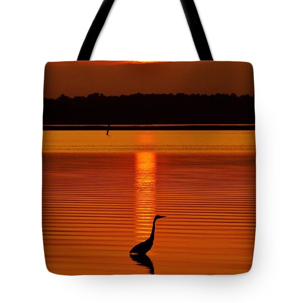 Bayside Ripples - A Heron Takes An Evening Stroll As The Sun Sets Behind The Clouds On The Bay Tote Bag