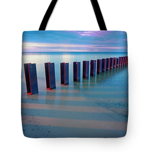 Beach Pylons At Sunset Tote Bag by Martin Konopacki